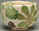 Shiroraku Tea Bowl With Green Leaves Made By Rakunyu